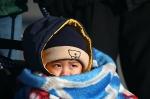 Boy wrapped in blanket - Beijing