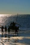 Fishing catamaran beaching